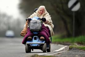 1 old woman on mob scooter