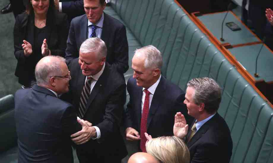 scott morrison being congratulated on budget - why