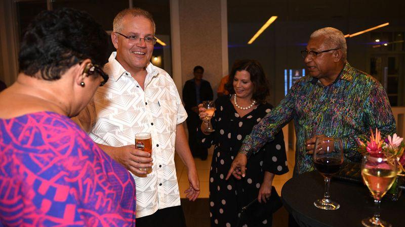 frank-bainimarama-points-to-australian-prime-minister-scott-morrisons-sulu-vaka-taga-as-he-arrives-in-traditional-bula-dress-with-hi