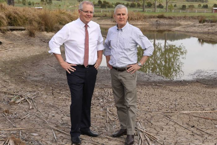 scott morrison and michael mccormack in business attire at dry dam